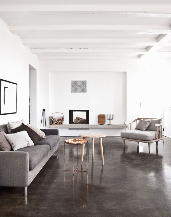 Sleek dark gray concrete floors and basic furnishings in this apartment near Copenhagen. Styled by Pernille Vest and shot by Jonas Bjerre-Poulsen for Elle Decoration