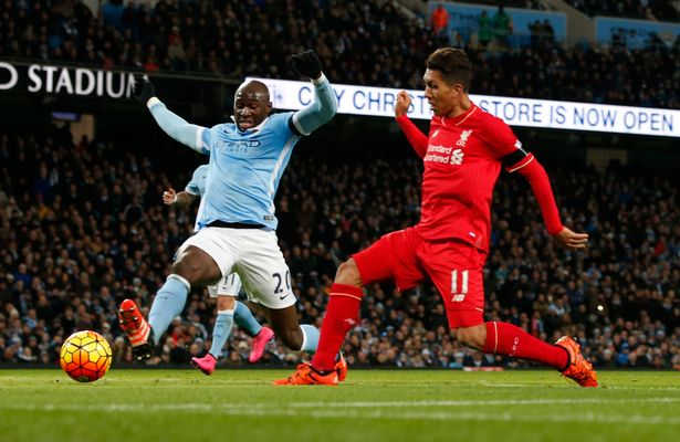 Three and easy: Firmino pokes home...