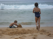 Dad, Seb and Paris spent all their time playing in the sand and swimming. (beach fun)