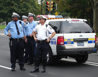 Source: http://commons.wikimedia.org/wiki/File:Philadelphia_Police_-_gang_with_vehicle.jpeg