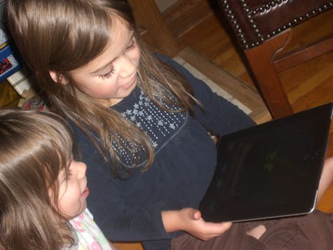 Girls playing with the iPad app from Cypher Entertainment