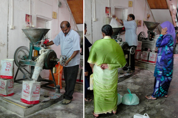 antique spice grinder machine grinding rice into flour for putu mayam in penang
