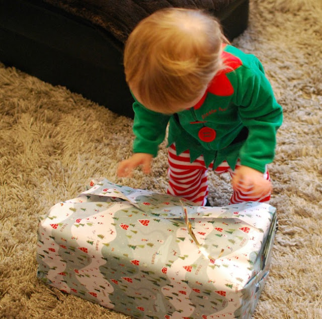 picture of toddler opening present