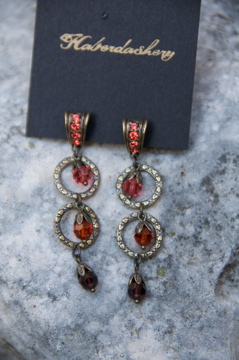 Earrings...posts with double circles in dark coral crystals and brass details
