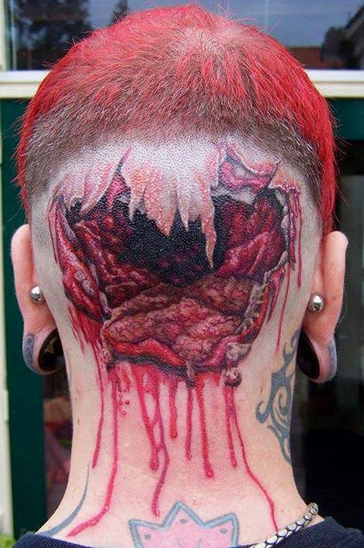 A tattoo of a cracked head on the back of the head