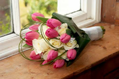 white rose and pink tulip brides bouquet