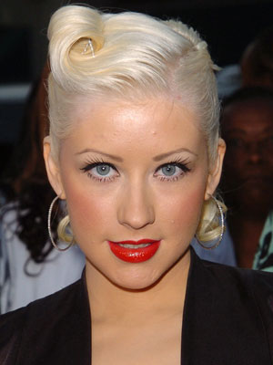 A sweeping barrel curl adds a unique balance to Christina Aguilera's polished updo.