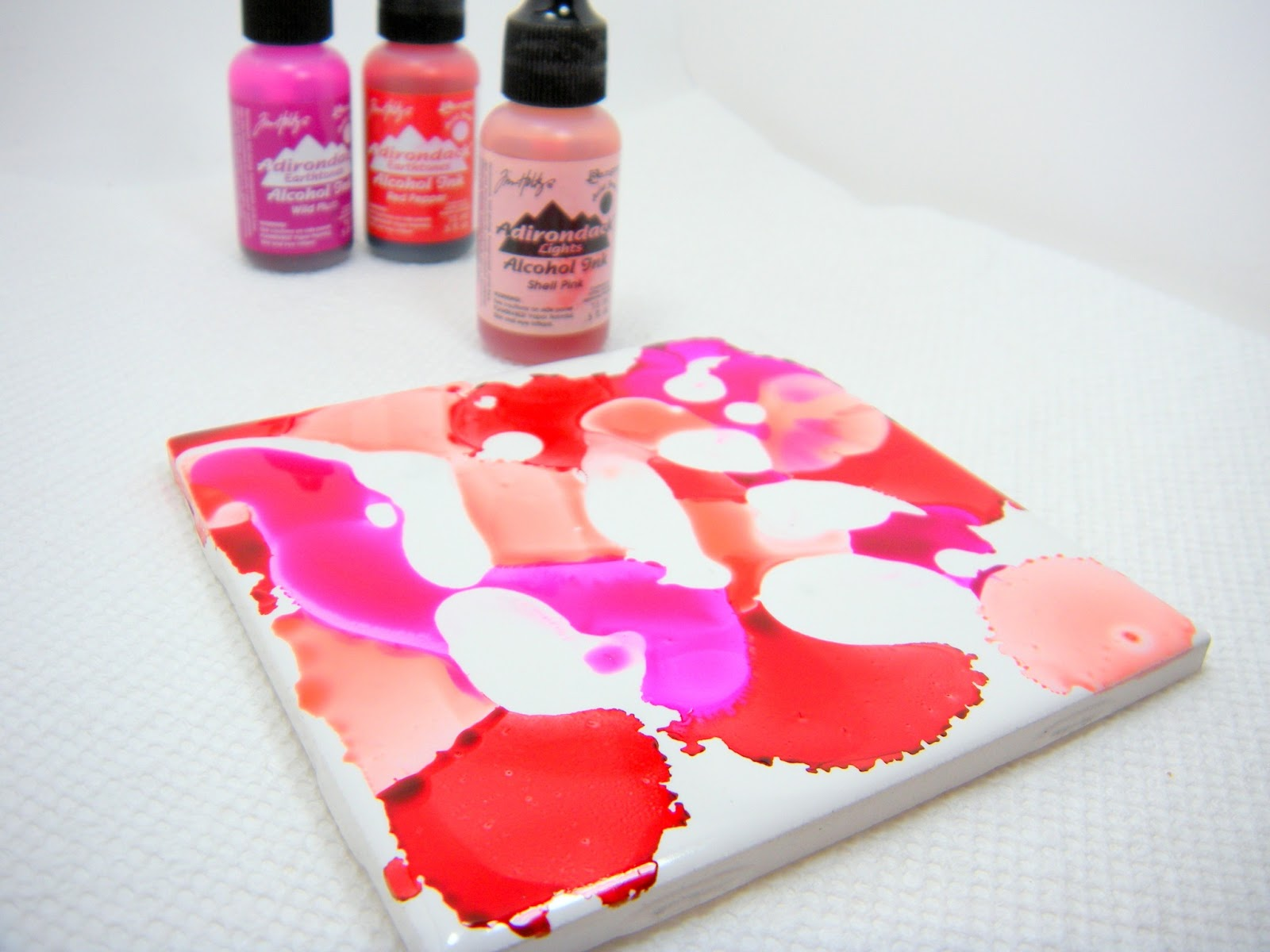 Accidentally excellent diy alcohol ink coasters 2 part tutorial once youve got the colors placed where you want them grab your felt applicators and begin lightly dabbing the tile all over try to avoid dragging the baditri Images