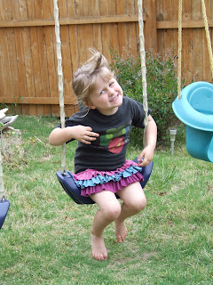 Girl in refashioned boy t-shirt made into a girl's dress