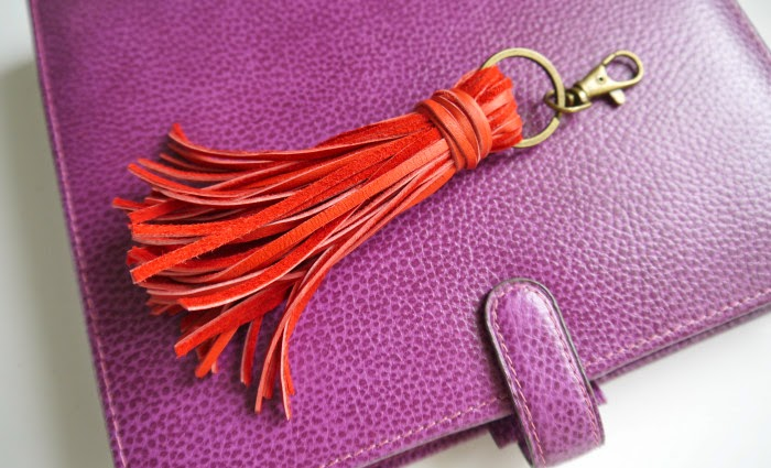 http://www.makery.uk/2015/02/diy-leather-tassle-key-fobbag-charm/