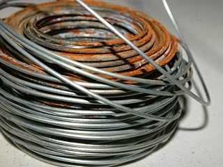A roll of iron wire full of rust.