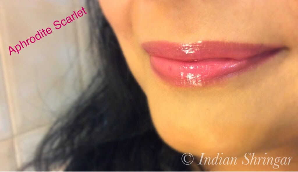 L'Oreal Rouge Caresse Aphrodite Scarlet lip swatch.