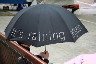 It's raining again, umbrella, funny umbrella, it's raining again umbrella,