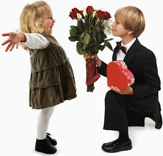 small boy purposing a girl by giving Roses