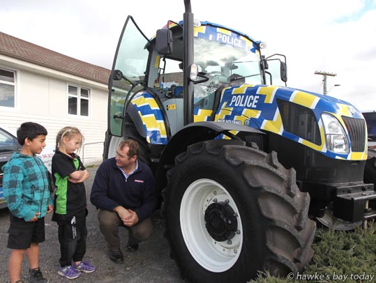 Children from Meeanee School try out the controls of a Police Tractor outside the Meeanee Hall, Meeanee, Napier, as part of a Meet-the-Police promo for people from Hawke's Bay's rural communities. photograph