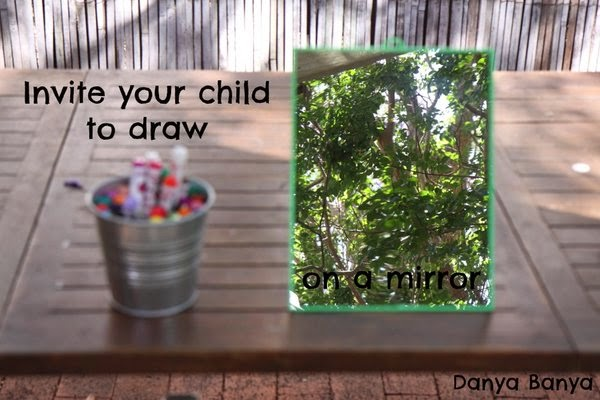 Invite your child to draw on a mirror with textas