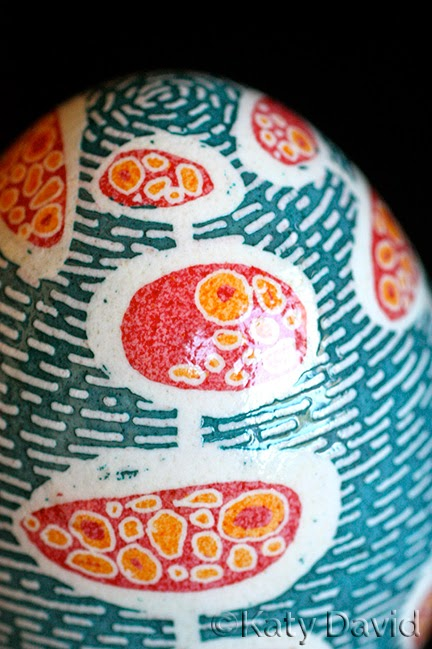 ©Katy David Friday Egg: Bubble Bubbles Goose Egg Pysanky in blue, white, orange and pink