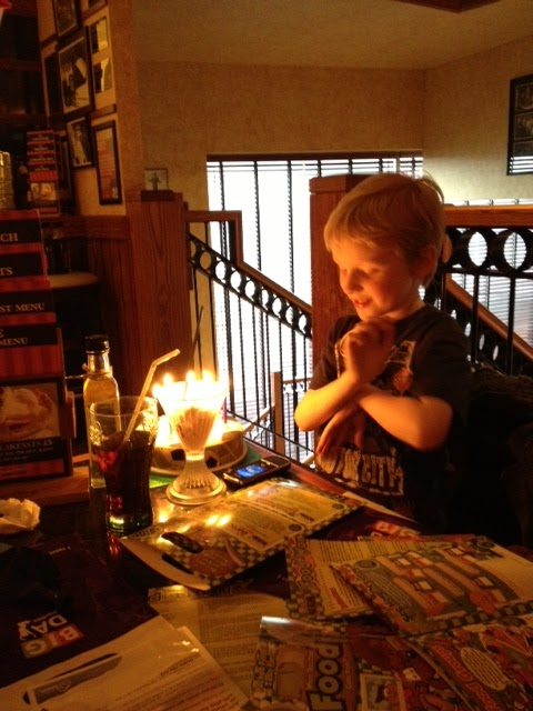 birthday boy with candles. Toys for kids