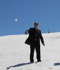 bishop throwing a snowball