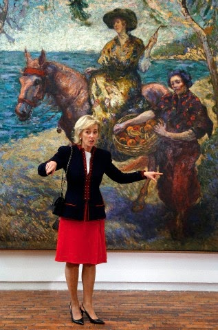 Belgium's Princess Astrid, gestures to the media as she poses for a photo during her visits to the Modern Art Museum of Bogota