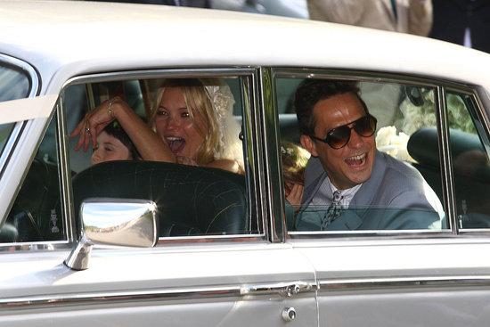 Kate Moss heading into her wedding in a silver Rolls Royce wearing John