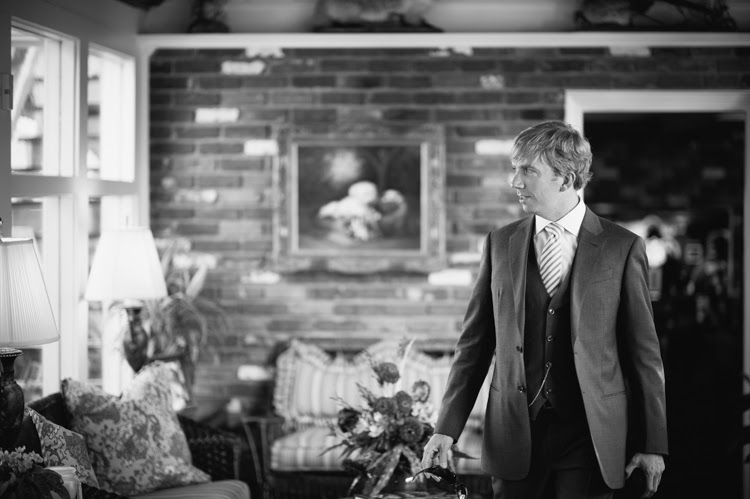 groom walking into the house before the wedding