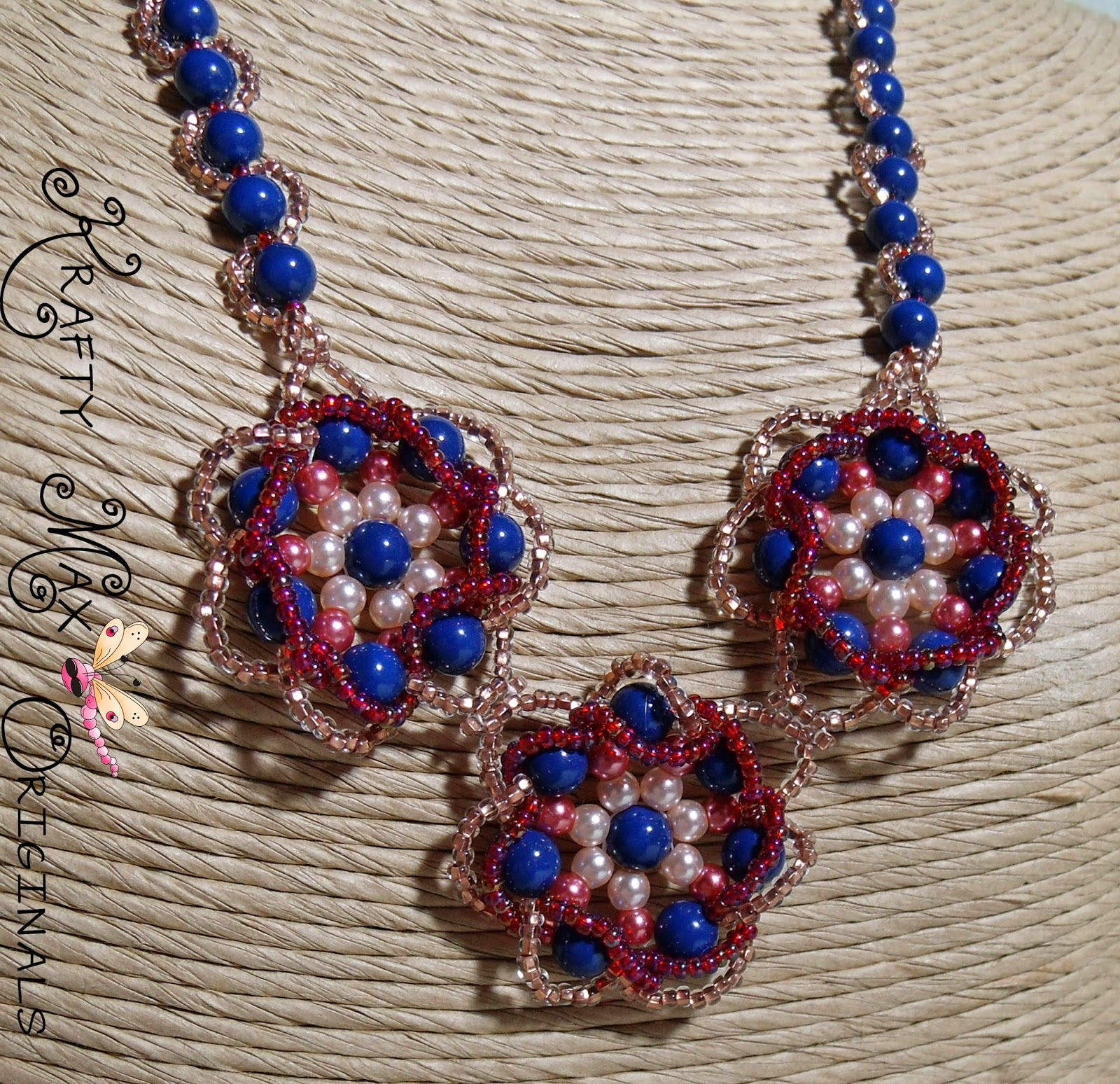 http://www.artfire.com/ext/shop/product_view/KraftyMax/9740780/blue_flowers_bursting_w_spring_swarovski_pearl_beadwoven_necklace_set/handmade/jewelry/necklaces/beadwoven