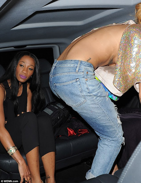 Photos- Rihanna narrowly avoids a wardrobe malfunction in braless top and ripped jeans
