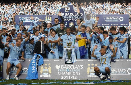 The Manchester City team celebrate winning the Premier League title