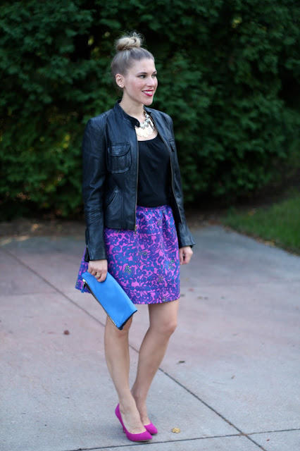 black tank, black moto jacket, pink and blue floral skirt, statement necklace, blue Clare V. clutch, pink heels