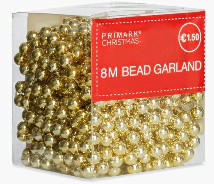 Primark online: tira de bolitas doradas para decorar en Navidad