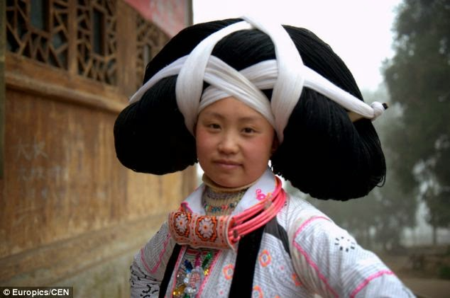 Miao Lady Wearing Hair Dress made from their dead ancestors