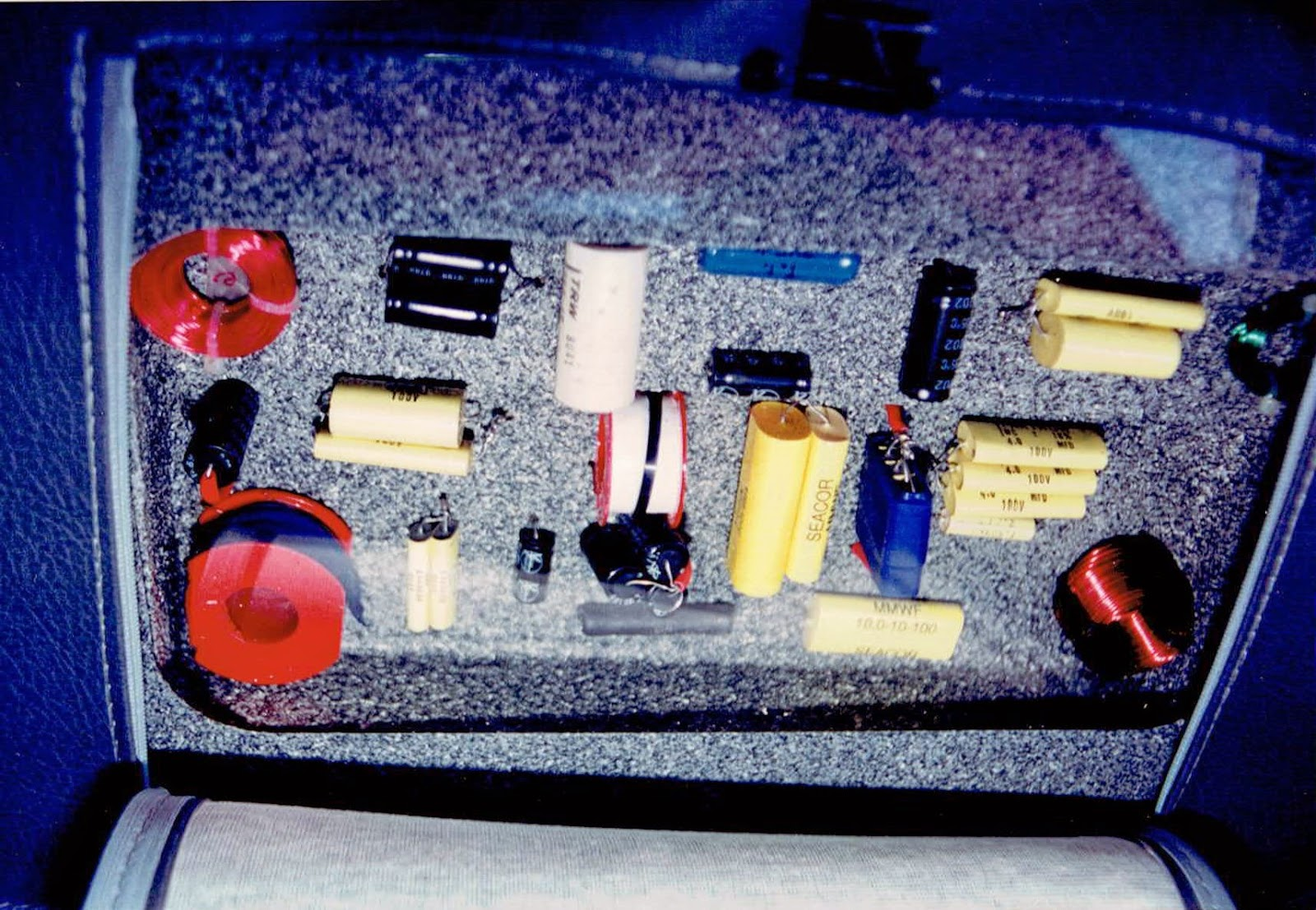 Photo of the passive crossovers inside the front seats in Alberto A Lopez's 1991 Red NIssan Sentra