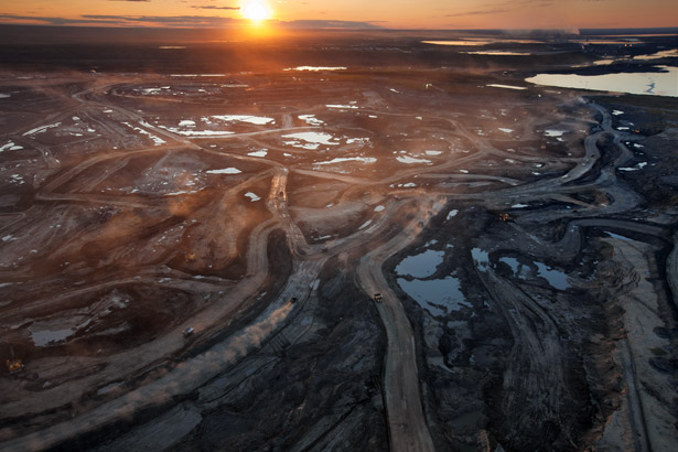 large area of tar sands strip mining area with roads through it