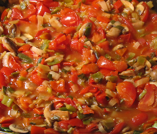 Cooking Tomato Sauce with Veggies