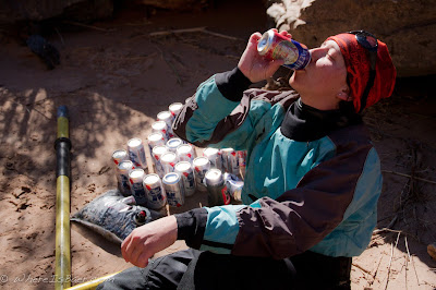 Kelly Bergdolt enjoying one of her rescued beers after her flip at Crystal, Colorado river, grand canyon Chris Baer