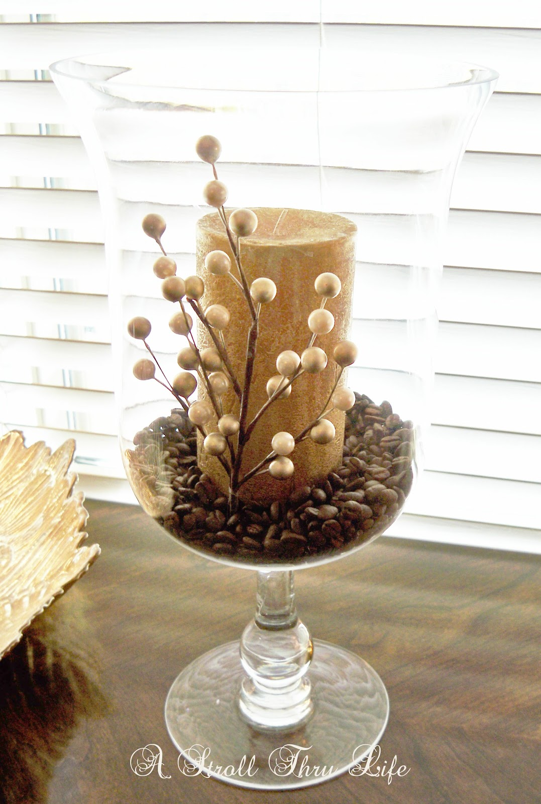 Anchor your candles in coffee beans for looks and aroma