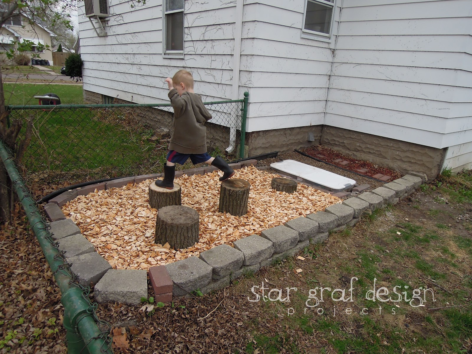 I Got A Couple Bags Of River Rock Pebbles Because My Boys Absolutely LOVE  Rocks. The Red Wood Chips Were Already There, But The White Wood Chips We  Laid ...