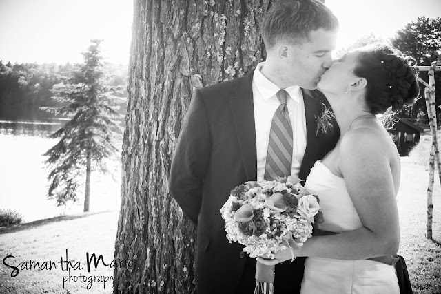 wedding couple kissing by a tree