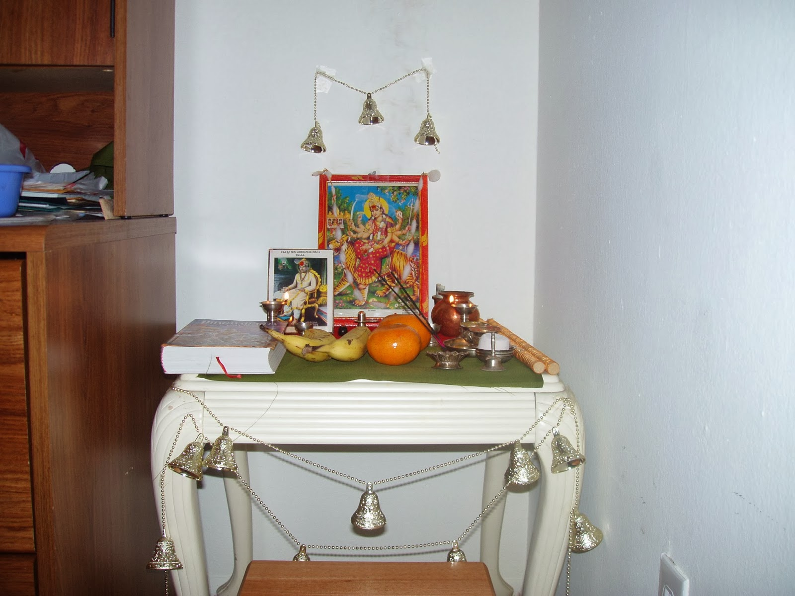 weekend tweaks my pooja space in our home so set up my pooja space on a table on a book shelf and also had it on a wall shelf these are the only two pictures i found from the album