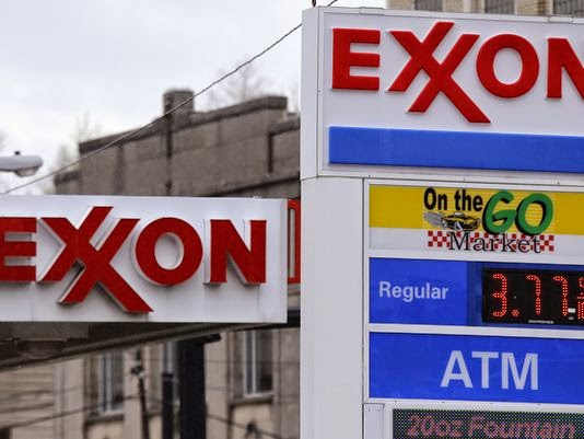 ExxonMobil, the world's largest publicly traded oil and gas company, assumes in its business plans that there will be an eventual U.S. price on heat-trapping carbon dioxide emissions. It's one of 29 major U.S.-based companies to put an internal price on carbon, according to a report Sept. 15, 2014, by the London-based non-profit research group CDP, formerly the Carbon Disclosure Project. (Credit: Gene J. Puskar, AP) Click to enlarge.