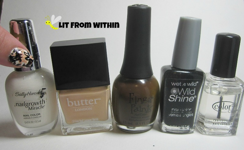Bottle shot:  mixed white, Butter London Shandy, Finger Paints Sketchy Character, Wet 'n Wild Black Creme, Color Club clear