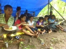 family from Poshyer village having their lunch under a temporary shed at 2nd Mile, Kalimpong