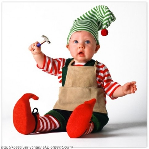 Baby in costume a  Christmas elf.