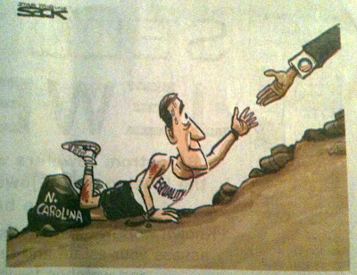 Political cartoon of a guy in running clothes labeled equality who has tripped on a rock while running uphill. An arm with an Obama campaign logo reaches down to give him a hand up