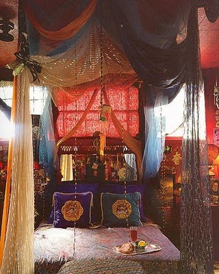 types of fabric and pattern is what brings this gypsy bedroom to life