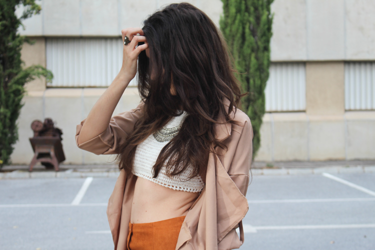 Suede skirt, camel trench, spiked boots, hat, silver necklace, knit bikini