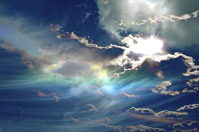 sun through blue clouds