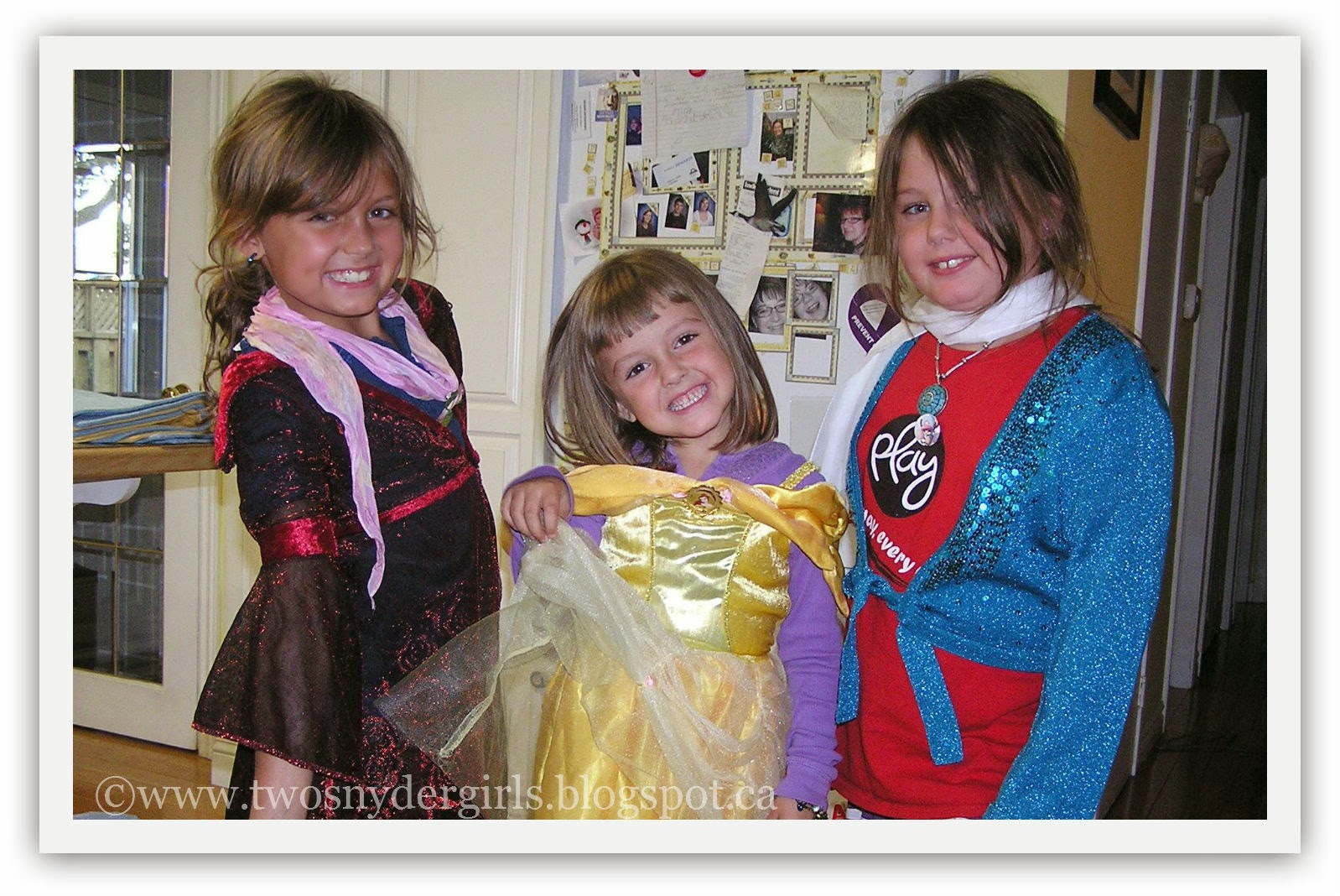 Three children playing dress up