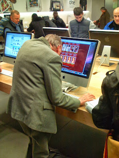funny picture: grandfather visiting dating site in a Mac shop